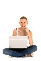 Teenage girl sitting with laptop
