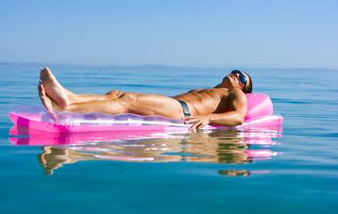Man on inflattable raft