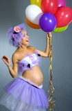 Pregnant woman with balloons