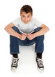 Boy in jeans sitting on floor