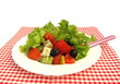 Greek salad with olives, cheese and fresh vegetables