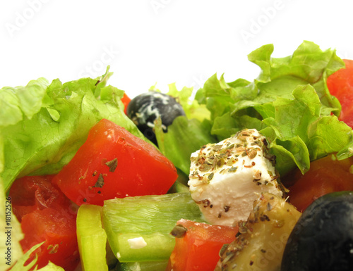 Greek salad with feta cheese, olives and fresh vegetables