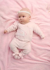 a young and beautiful baby in pink