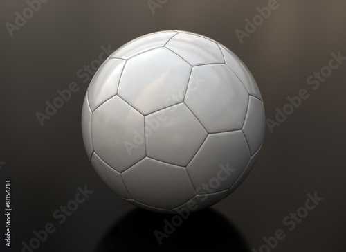 Soccer ball on shiny floor