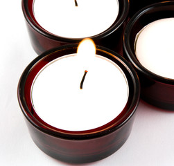 red votive candles lit