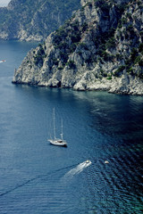 Boat and Sailboat off Cliffs