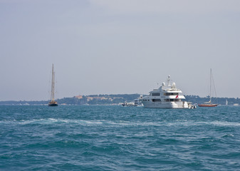 Yacht and Sailboats in Bay