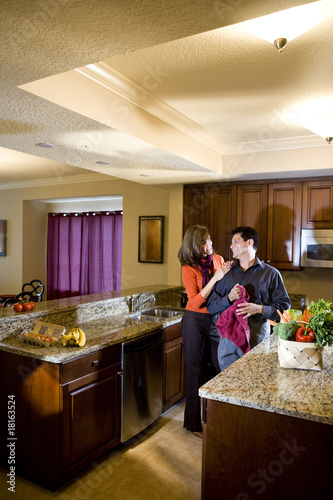 Middle aged couple together in kitchen at home