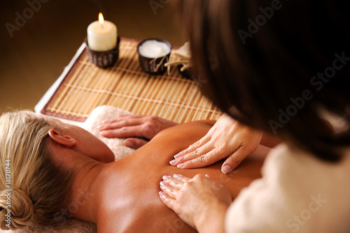 Leinwanddruck Bild massaging  backbone of woman
