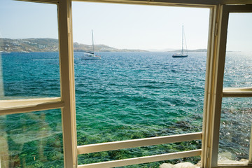Window view on the bay of Mykonos, Greece