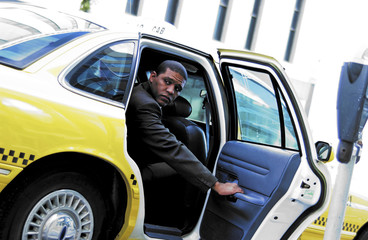 Businessman getting into cab