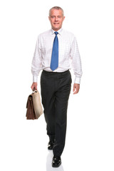 Mature businesman walking towards