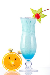 Blue tropical cocktail with coconut cream and orange face