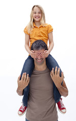 Father giving daughter piggyback ride with closed eyes