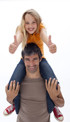 Father giving daughter piggyback ride with thumbs up