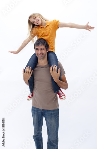 Father giving happy daughter piggyback ride