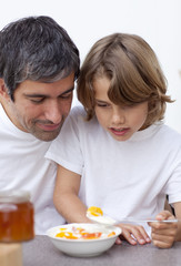 Portrait of dad and boy having breakfast together