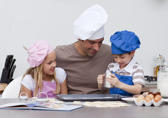 Father and children baking in the kitchen