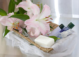 toiletries in basket and pink lily poster