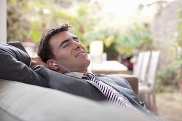 Businessman relaxing at home