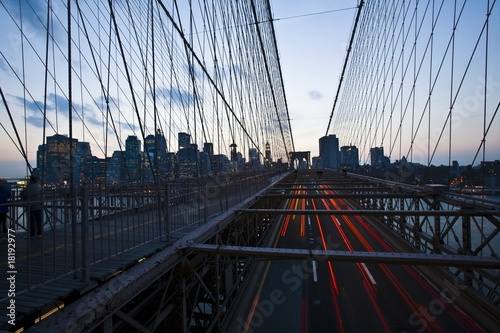 broooklyn bridge with view of manhattan at dusk