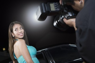 Female celebrity being photographed at media event
