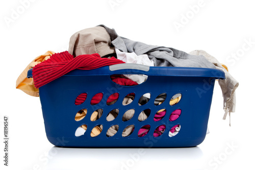 Blue laundry basket full of dirty clothes
