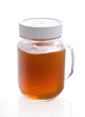 Glass jar with raw honey