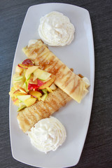pancakes with ice-cream and fruit salad