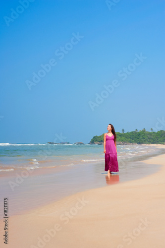 poster of pleasant woman walking at the beach
