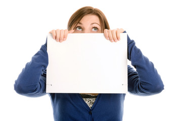 Woman covering face with blank note card and looking up
