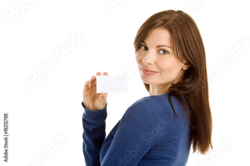 Young woman holding blank business card smiling