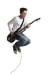 The young guy with a bass guitar in a jump.