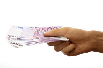 Euro banknotes in the men's hand. Isolated on white.