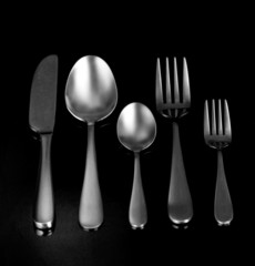 Silver cutlery, on black background