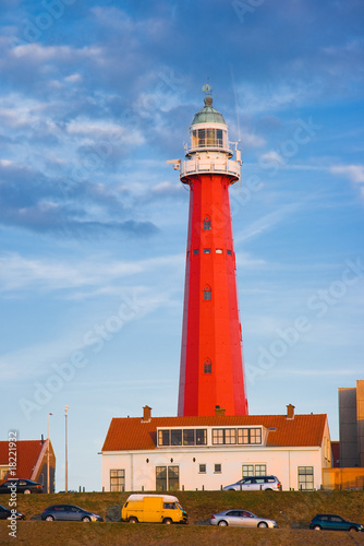 Red lighthouse in evening light - 18221932