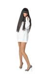 bare-legged raven haired girl in short white shirt isolated poster