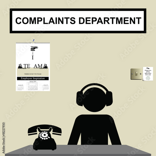 Worker in customer complaints department wearing ear defenders