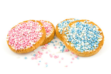 Rusk with blue and pink mice over white background