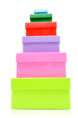 Stacked colorful packaging boxes over white background