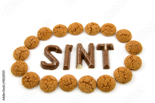 "The word ""Sint"" in chocolate letters over white background"