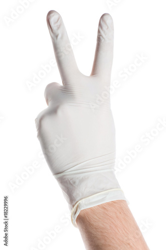 Hand dressed in medical glove showing victory sign isolated on w