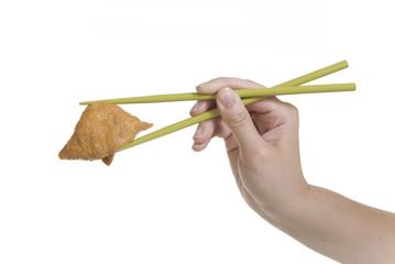 hand holding inari sushi