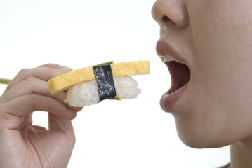 woman eating tamago nigiri