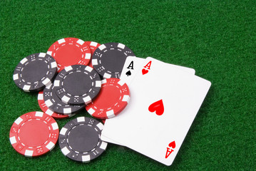 par of aces and some poker chips