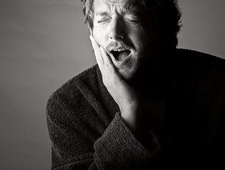 Dramatic Black and White Shot of a Man in Pain