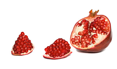 Pomegranate segments and cross-section isolated on white backgro