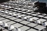 Salt piles on a saline exploration near Teneguia volcano poster