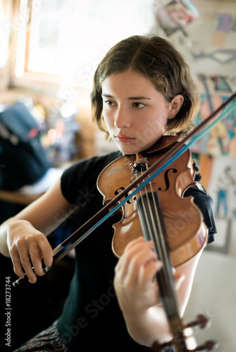 Pretty Young Woman Practicing Violin