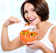 smiling young woman eats  salad